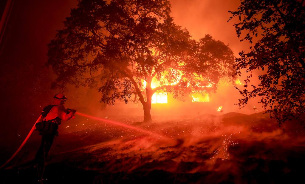 A home near St. Helena burns in the Glass fire, Sunday, Sept. 27, 2020. (Kent Porter / The Press Democrat)