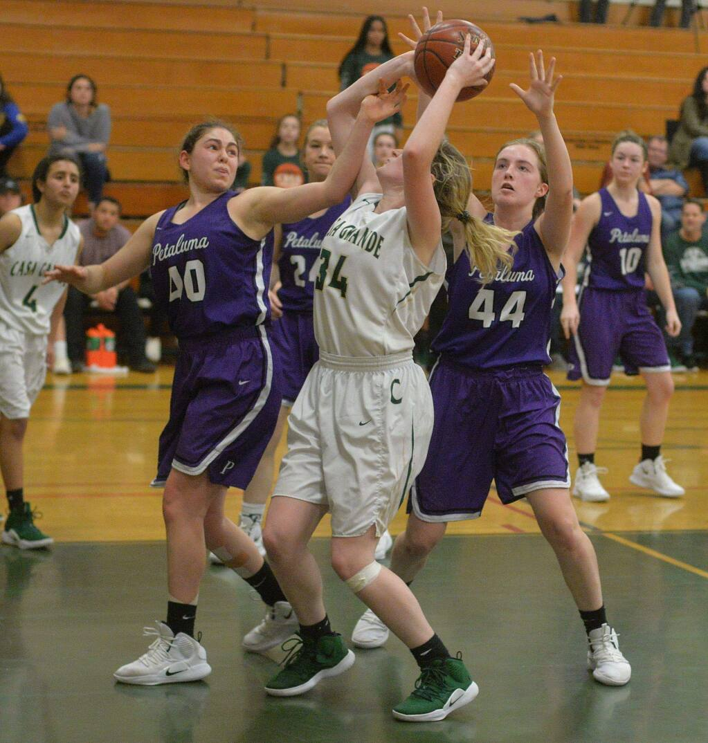 SUMNER FOWLER/FOR THE ARGUS-COURIERPetaluma defenders Sheriene Arikat (40) and Rose Nevin (44) surround Casa's Samantha Dedrickson in a game played last season. Both Arkat and Nevin return for the T-Girls.