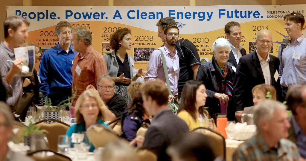 At the Business of Local Energy Symposium in Petaluma, Thursday Oct. 23, 2014 convention goers take a break from meetings to file in for their lunch. (Kent Porter / Press Democrat) 2014
