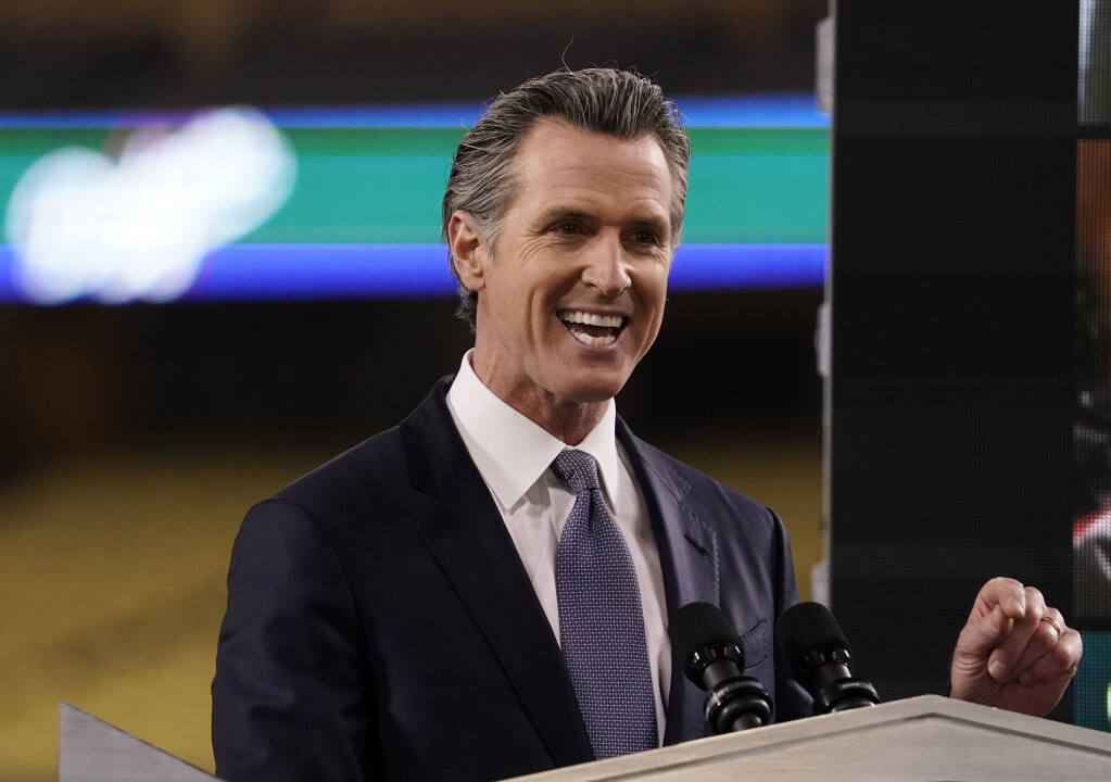FILE - In this Tuesday, March 9, 2021, file photo, California Gov. Gavin Newsom delivers his State of the State address from Dodger Stadium in Los Angeles. Newsom and his Democratic allies launched a political committee Monday, March 15 to stop a proposed recall election that could oust him from office.  (AP Photo/Mark J. Terrill, File)
