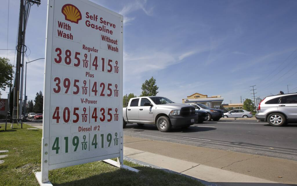 Gas prices are displayed at a Shell station Tuesday, April 23, 2019, in Sacramento, Calif. California Gov. Gavin Newsom wants to know why the state's gas prices are higher than the rest of the country. Newsom asked the California Energy Commission on Tuesday for an analysis of the state's gas prices by May 15. (AP Photo/Rich Pedroncelli)
