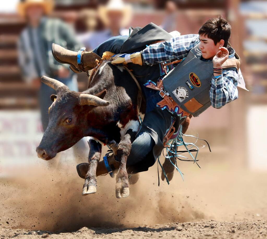 Blake Bishop, 13, of Windsor won the junior steer riding competition on Saturday at the 51st annual Russian River Rodeo in Duncans Mills. (John Burgess/The Press Democrat)