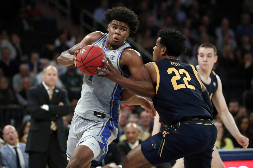 Duke center Vernon Carey Jr. (1) maneuvers around Cal forward Andre Kelly (22) during the first half of the first round of the 2K Empire Classic, Thursday, Nov. 21, 2019, in New York. (AP Photo/Kathy Willens)