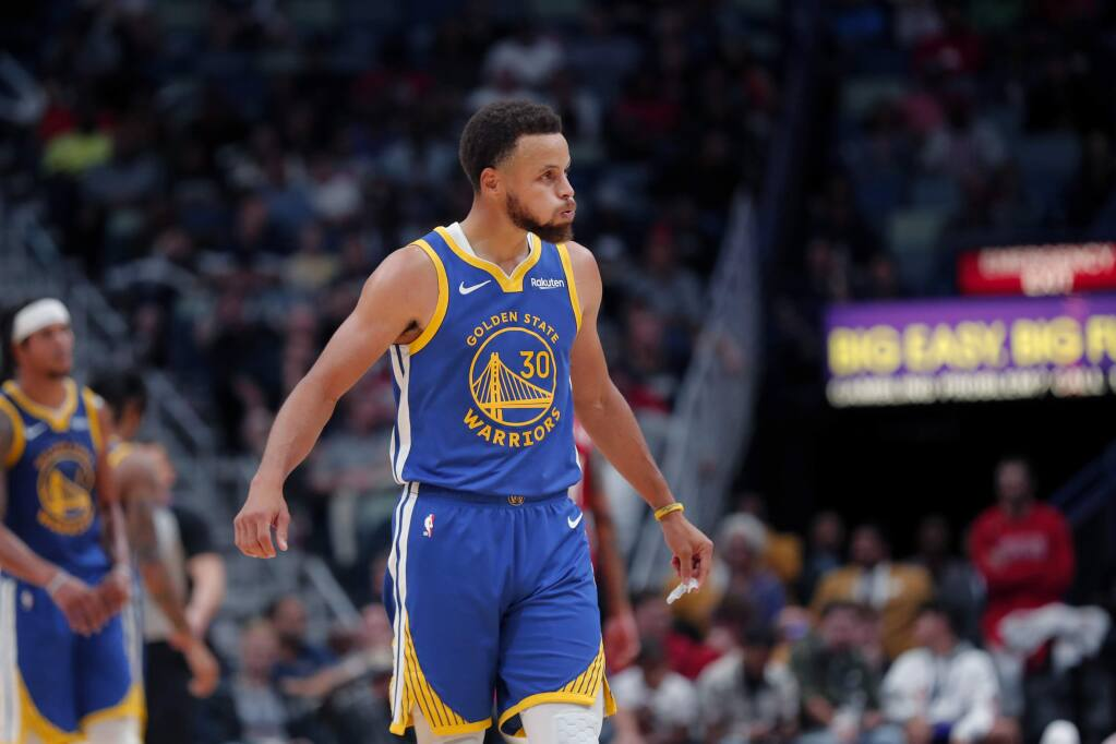 Golden State Warriors guard Stephen Curry reacts after being called for a foul in the second half of against the New Orleans Pelicans in New Orleans, Monday, Oct. 28, 2019. (AP Photo/Gerald Herbert)