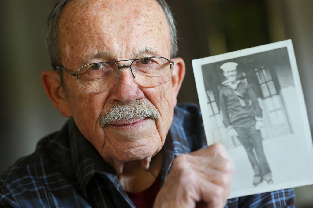 George Hudson holds a photograph of his father, Charles Hudson, a sailor on the USS Oklahoma that died in the attack on Pearl Harbor. Charles Hudson's body was never identified until recently. George Hudson and his wife, Leslie, will attend a reburial ceremony with honors for Charles Hudson at the National Cemetery of the Pacific on Oahu on Sept. 10. (Christopher Chung / The Press Democrat)