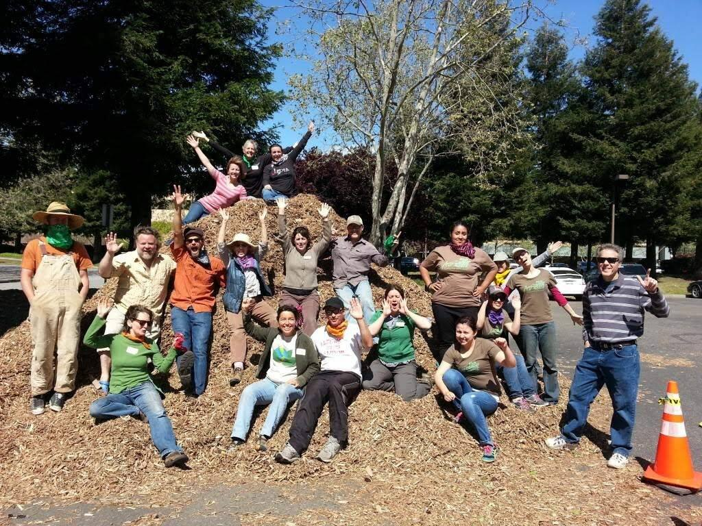 Clear Blue Commercial employees surround 'Mulch Mountain' during ìMulchstock,î a phase 3 turf-conversion project at 1425 N. McDowell Blvd. in Petaluma designed to save 250,000 gallons of water annually. Mulchstock was founded by Clear Blue in collaboration with Daily Acts, the city of Petaluma and Sonoma County Water Agency. (courtesy photo)