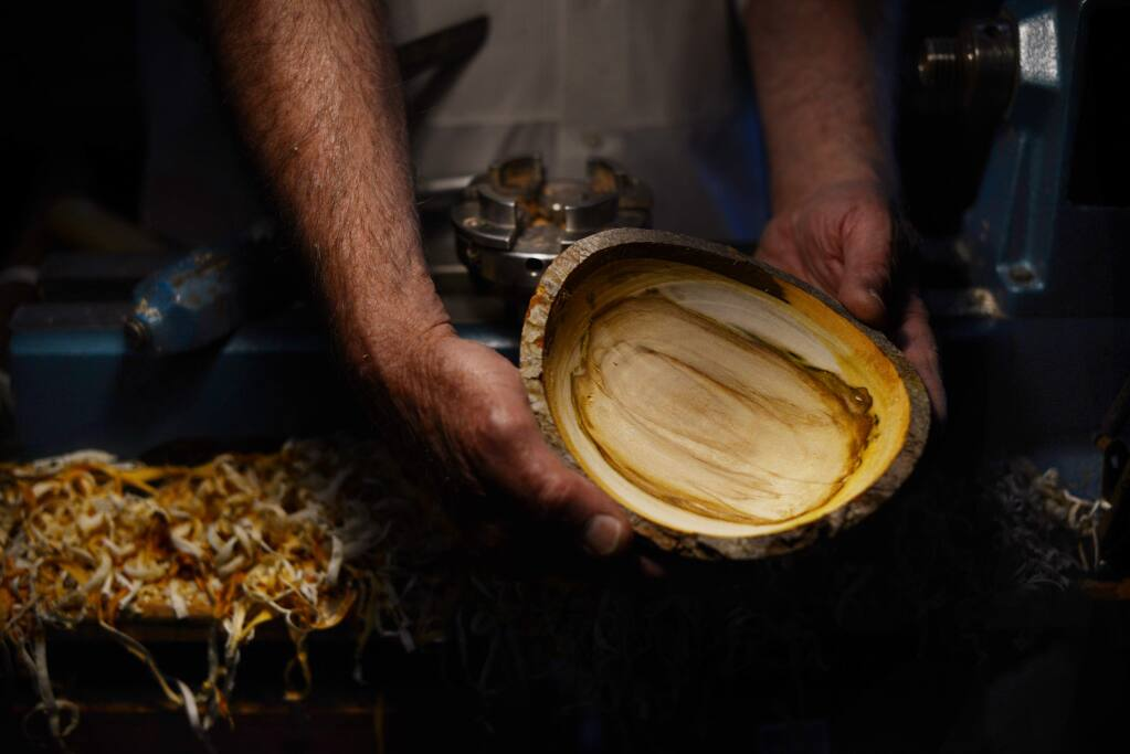 Woodturning artist Jerry Kermode making a Silver Maple wood bowl that he donated for the silent auction during Empty Bowls, the 7th annual dinner and art auction; a benefit for the Redwood Empire Food Bank held Saturday in Santa Rosa. April 29, 2017.(Photo: Erik Castro/for The Press Democrat)