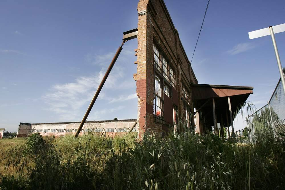 Condo construction that incorporates the walls of the century-old cannery in Santa Rosa's historic Railroad Square has been delayed for years. (CHARLIE GESELL/ PD)