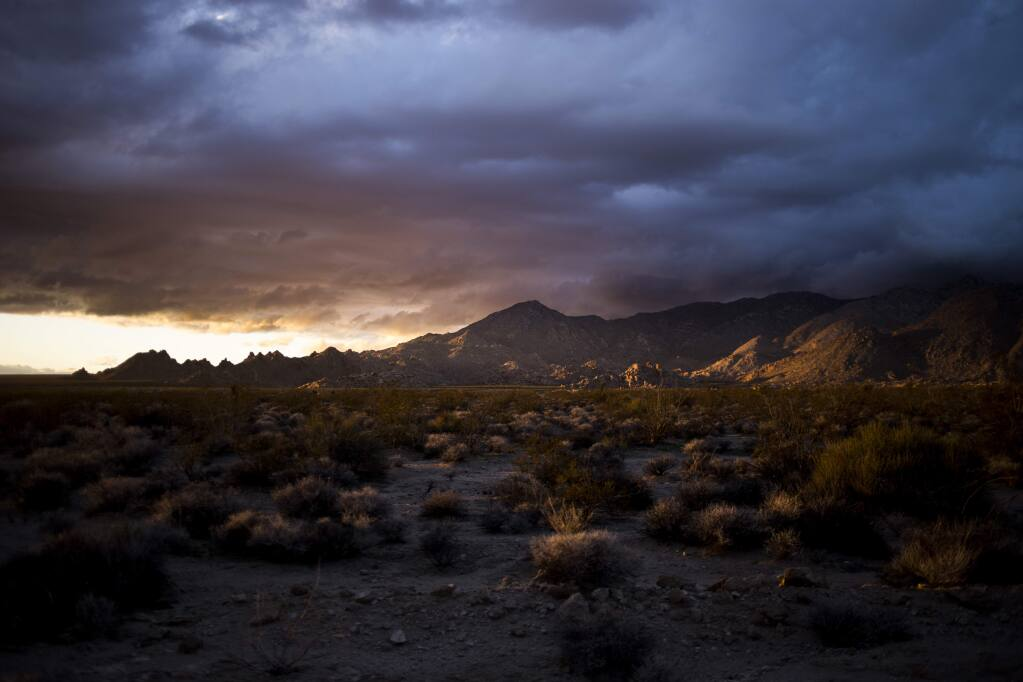 The sun sets on the Mojave National Preserve in Kelso, Calif., on Feb. 5. The public lands bill passed by the Senate Tuesday would connect the preserve with Death Valley National Park. MUST CREDIT: Photo for The Washington Post by Jenna Schoenefeld