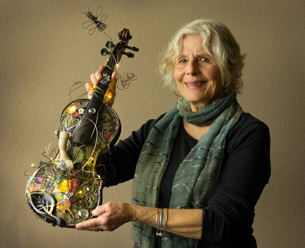 Artist Marylu Downing created this violin for the Santa Rosa Symphony League fundraiser for the Santa Rosa Youth Orchestra's trip to Europe. (Photo by John Burgess/The Press Democrat)