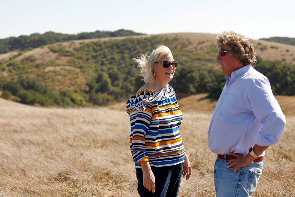Sonoma County 1st District supervisor Susan Gorin, left, talks with Justin Faggioli, brother-in-law of property owner Bruce Donnell, during a tour of Donnell Ranch, a 978-acre property that was recently preserved from development, near Sonoma, California, on Friday, Sept. 7, 2018. (ALVIN JORNADA/ PD)