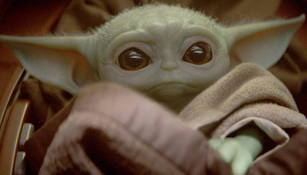 Baby Yoda is known simply as 'the Child' in 'The Mandalorian,' the first live-action 'Star Wars' series. (DISNEY PLUS)