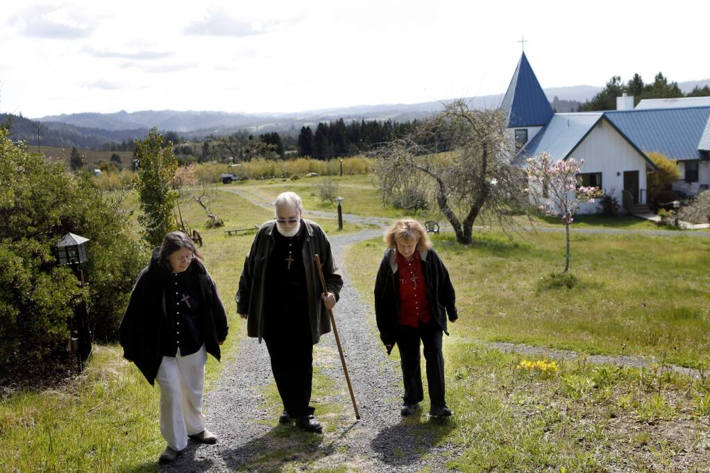 Sister Marti Aggeler, Brother Toby McCarroll, and Sister Julie De Rossi walk up the hill to the chapel for a mid-day communion service at the Starcross community in Annapolis on Wednesday, April 4, 2012. (BETH SCHLANKER/ PD FILE)