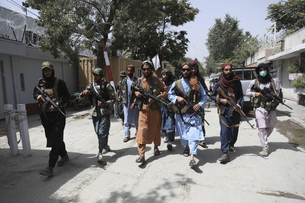 Taliban militants violently disperse rare Afghan protest