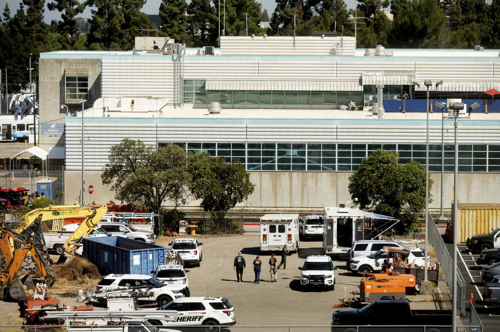 FILE - In this May 26, 2021, file photo, law enforcement officers respond to the scene of a shooting at a Santa Clara Valley Transportation Authority (VTA) facility in San Jose, Calif. A gunman who killed nine co-workers at a California rail yard last month was the subject of four investigations into his workplace conduct, according to internal documents published Thursday, June 10, 2021. (AP Photo/Noah Berger, File)