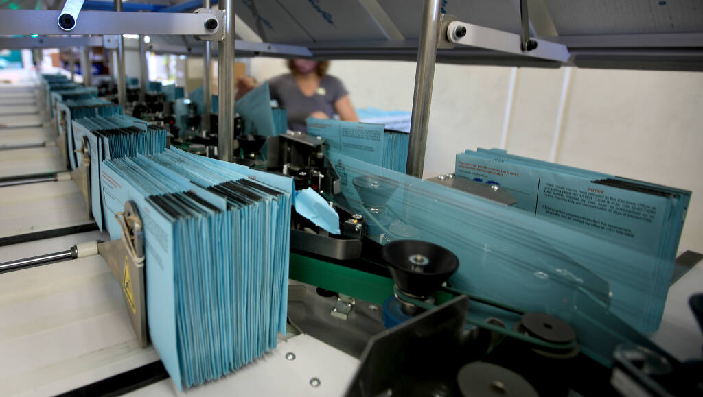 Mail in ballots are sorted into stacks on a signature verification system at the Sonoma County election office following the Nov. 3 election. (KENT PORTER / The Press Democrat)