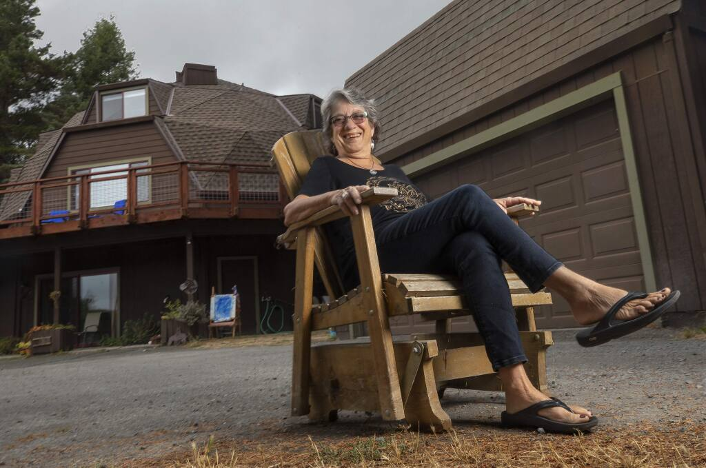 A recent county ordinance change allows Jennifer Mann to build a granny-unit above her garage on her rural property west of Sebastopol she shares with her kids and grandkids. (photo by John Burgess/The Press Democrat)