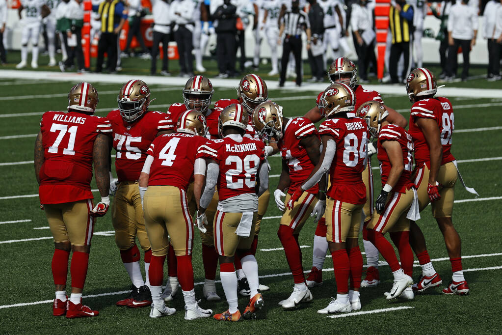 San Francisco 49ers quarterback Nick Mullens, No. 4, in a huddle against the New York Jets, Sunday, Sept. 20, 2020, in East Rutherford, New Jersey. (Adam Hunger / ASSOCIATED PRESS)
