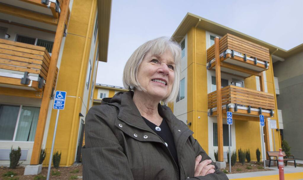 Ann Scarff stands outside Celestina Gardens, a senior affordable housing project on Highway 12 in Sonoma Valley. MidPen Housing completed the project in 2020. (Photo by Robbi Pengelly/Index-Tribune)