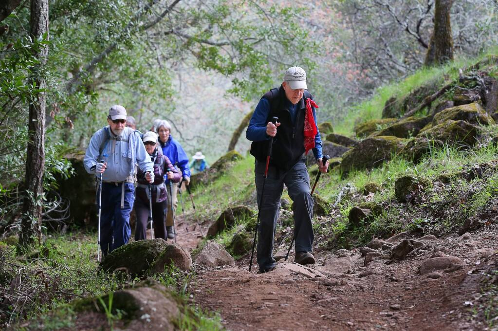 Dave Chalk, right, hikes with a social hiking group in Trione-Annadel State Park, in Santa Rosa on Tuesday, March 19, 2019. Chalk, along with Bill Myers, leads Bill & Dave Hikes, and the duo are looking for successors to continue their popular local hiking excursions.in Santa Rosa on Tuesday, March 19, 2019. (Christopher Chung/ The Press Democrat)