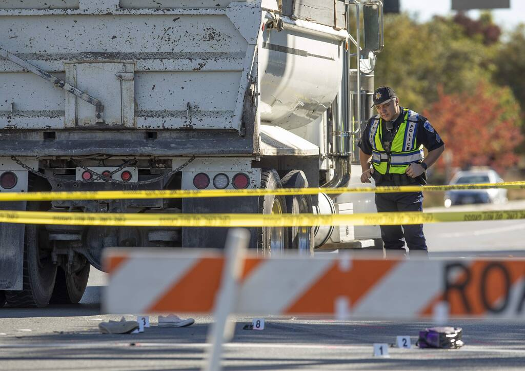 Santa Rosa Police Sgt. Chad Heiser investigates the scene of a fatal bike vs. debris truck accident on Stony Point Road on Tuesday, Oct. 30, 2018. (JOHN BURGESS/ PD)