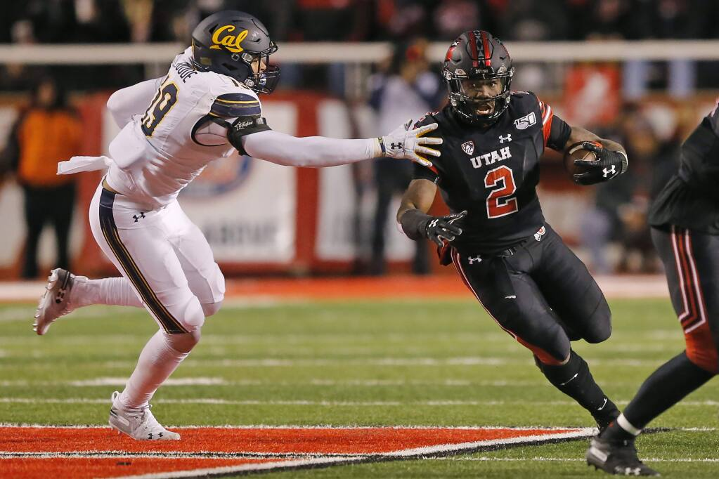 Utah running back Zack Moss (2) outruns Cal linebacker Cameron Goode (19) in the first half Saturday, Oct. 26, 2019, in Salt Lake City. (AP Photo/Rick Bowmer)