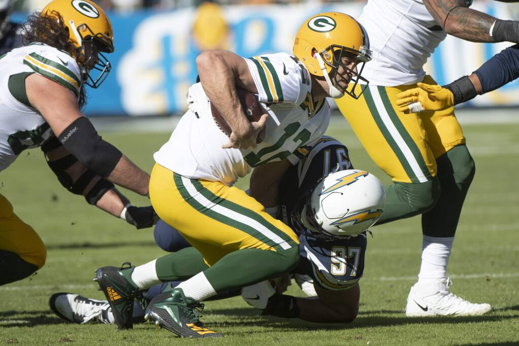 Los Angeles Chargers defensive end Joey Bosa, back, sacks Green Bay Packers quarterback Aaron Rodgers Sunday, Nov. 3 2019 in Carson. (AP Photo/Kyusung Gong)