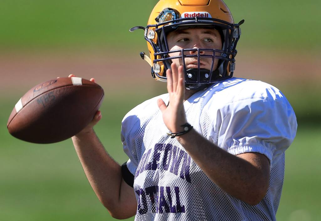 Middletown High School's quarterback Isaac Perez, Wednesday, Aug. 14, 2019 in Middletown. (Kent Porter / The Press Democrat)
