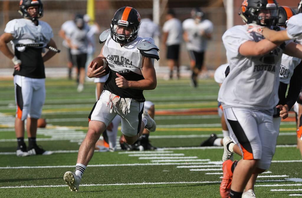Santa Rosa High School running back Mason Frost runs the ball during practice in Santa Rosa on Tuesday, Oct. 8, 2019. (Christopher Chung / The Press Democrat)