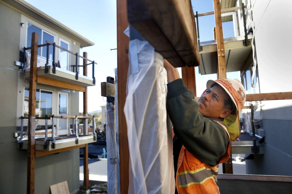 Javier Rodriguez of R.E. Maher Inc. prepares a balcony for concrete to be poured as work is ongoing at the new Fetters Apartment complex, part of the Sonoma Springs Hub,in Sonoma, on Wednesday, November 16, 2016. (BETH SCHLANKER/ The Press Democrat)