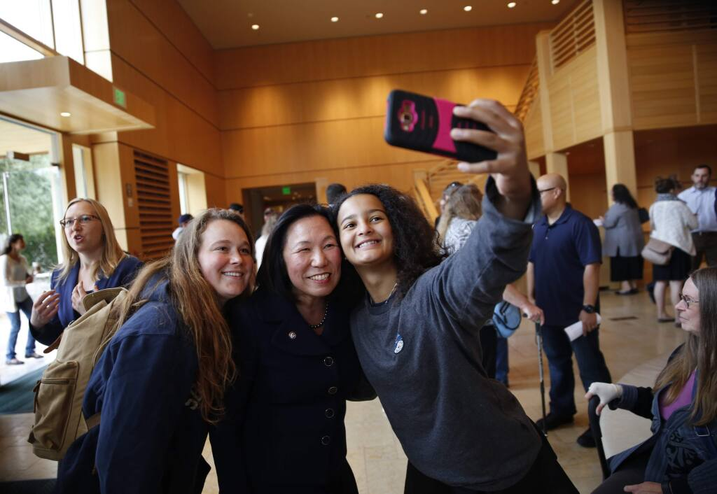 Sonoma State University President Judy Sakaki, center, poses for a photo with juniors Sophia Mahoney-Rohrl, left, and Emily Milesi before her first convocation at the Green Music Center on the Sonoma State University campus in Rohnert Park, on Monday, August 22, 2016. (BETH SCHLANKER/ The Press Democrat)