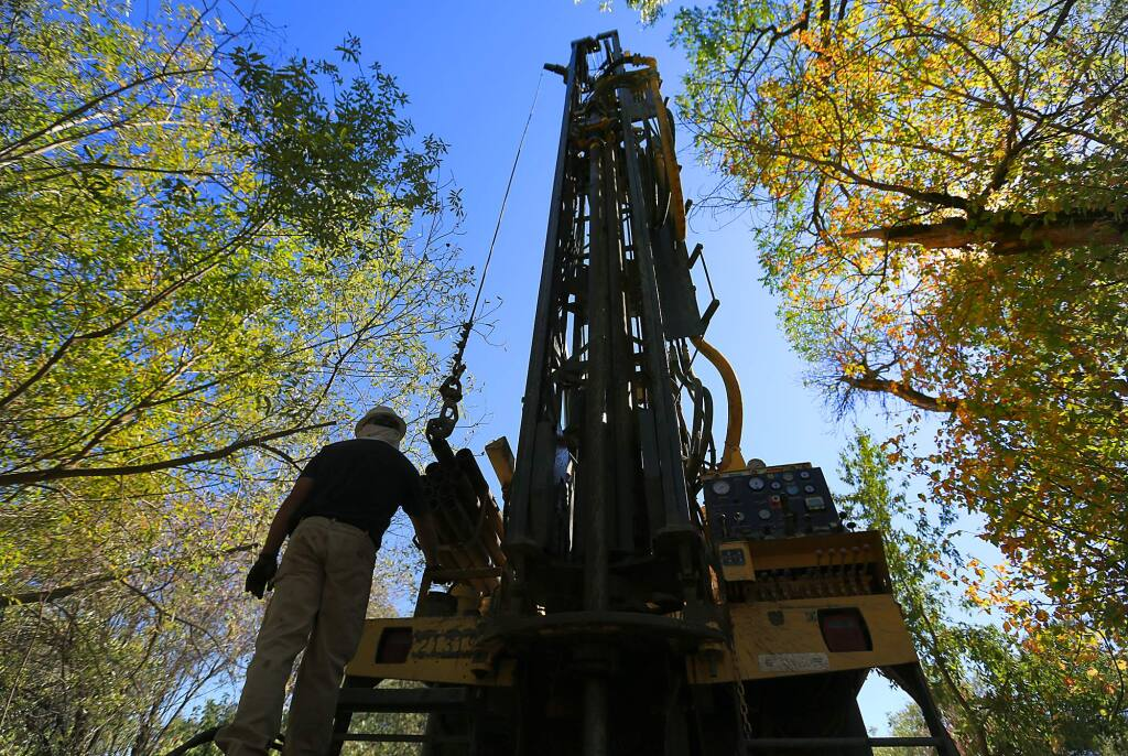 (FILE PHOTO) Well driller Tim Teller of Weeks Drilling monitors the boring of a test well Wednesday Sept. 4, 2013 in Cloverdale. (Kent Porter / Press Democrat)