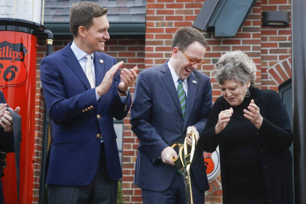 FILE - In this Nov. 6, 2019 file photo, Lieutenant Governor Matt Pinnell watches as Mayor G.T. Bynum and District 2 Councilor Jeannie Cue celebrate after cutting a ribbon during the opening of the Route 66 Village Station in Tulsa. Republican Sen. Nathan Dahm said Wednesday, Nov. 6, 2019 that he is done trying to rename a portion of the iconic Route 66 highway in northeastern Oklahoma after President Donald Trump. (Ian Maule/Tulsa World via AP, File)