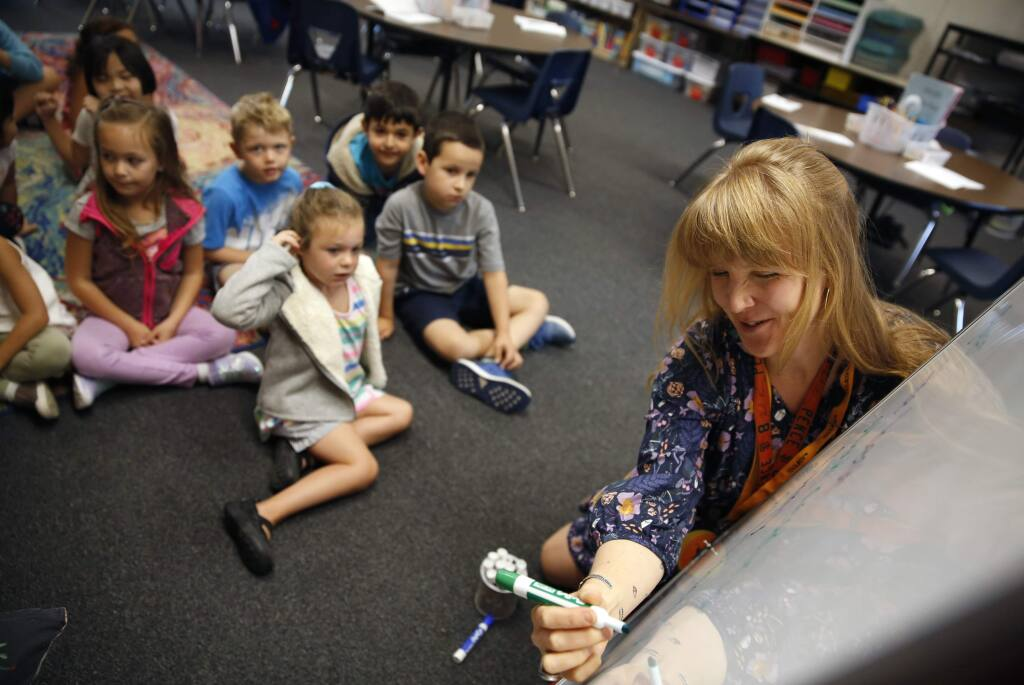 Teacher Meta George writes down her students descriptions of first grade during class at Hidden Valley Elementary School in Santa Rosa on Wednesday, August 22, 2018. (Beth Schlanker/ The Press Democrat)