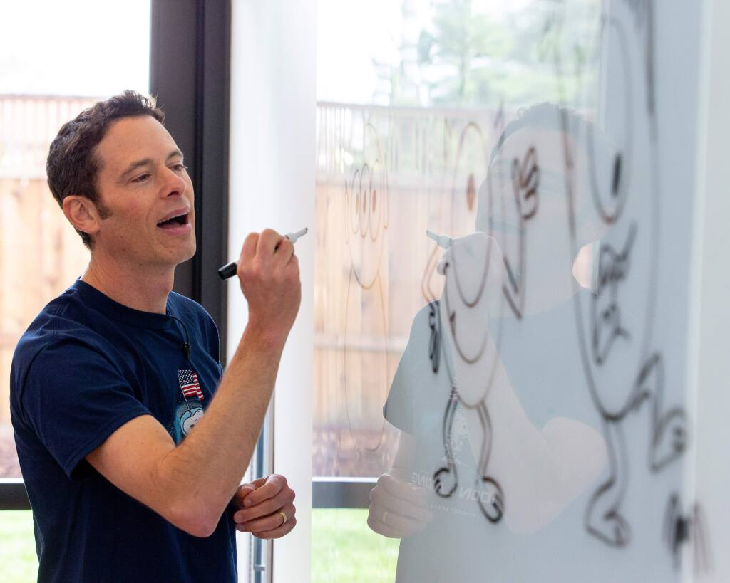 Illustrator and animator Matthew Luhn shows attendees of all ages how to draw characters from the Pixar animated films he has worked on, at the Charles M. Schulz Museum and Research Center in Santa Rosa, California, on Saturday, January 11, 2020. (Alvin Jornada / The Press Democrat)