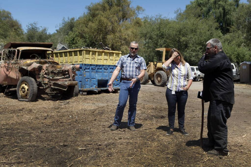 The Sampson property on Liberty Road gets cleaned up July 12, 2016 after Sonoma County got a court order to remove years worth of trash and debris. Owner Tony Sampson (right) talks with Tennis Wick, director of Sonoma County's Permit & Resource Management Department (left) and deputy county counsel Holly Rickett (center).(CRISSY PASCUAL/ARGUS-COURIER STAFF)