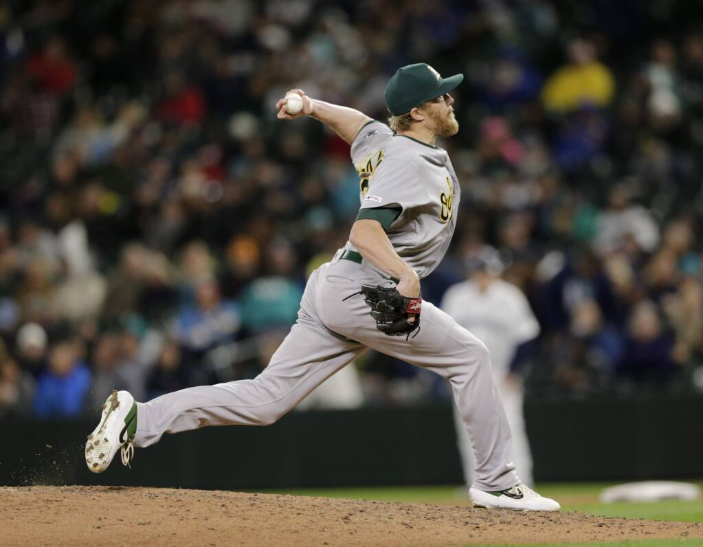 Oakland Athletics relief pitcher Jake Diekman works against the Seattle Mariners, Saturday, Sept. 28, 2019, in Seattle. (AP Photo/John Froschauer)