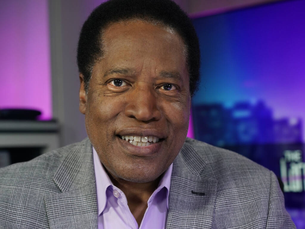Radio talk show host Larry Elder poses for a photo in his studio, Monday, July 12, 2021, in Burbank, Calif. Elder has announced he is running for governor of California. (AP Photo/Marcio Jose Sanchez)