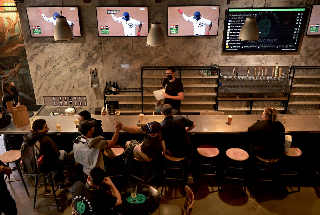 A Third Street Aleworks in Santa Rosa, a crowd begins to form for the evening dinner rush, Thursday, Aug. 12, 2021. (Kent Porter / The Press Democrat) 2021