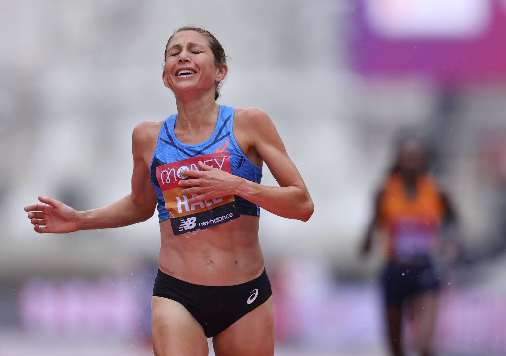 Sara Hall sprints to the finish line to take second place ahead of Kenya's Ruth Chepngetich in the London Marathon on Sunday, Oct. 4, 2020. (Richard Heathcote / Pool)