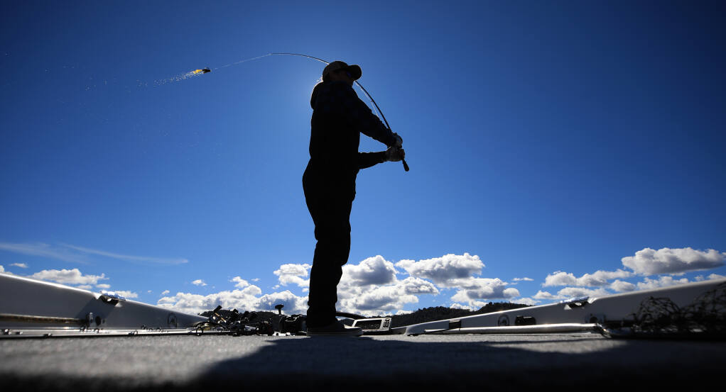 Josh Adams, 18, of Cloverdale, casts his line in to Clear Lake just offshore of incorporated Clearlake, Thursday, March 11, 2021 in Lake County.  Adams started his own business as a guide to the best fishing holes on the lake.  (Kent Porter / The Press Democrat) 2021