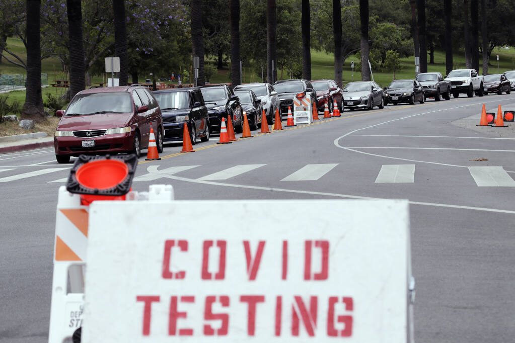 Motorists line up at a coronavirus testing site at Dodger Stadium Monday, June 29, 2020, in Los Angeles. Less than two months ago, Los Angeles had so many tests available for coronavirus that tens of thousands were going unused. Today, it's impossible to book an appointment. The current resurgence of the virus has spiked demand in LA and across the state for tests, leading to long lines and a fear that supplies will run low and create a bottleneck in a system that has taken months to expand. (AP Photo/Marcio Jose Sanchez,File)