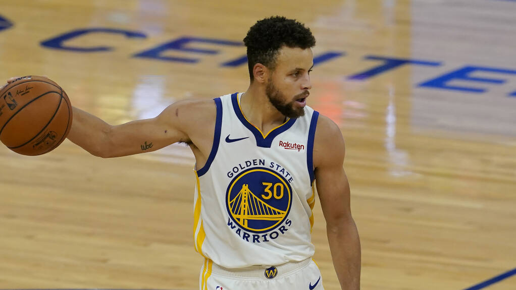 Golden State Warriors guard Stephen Curry (30) against the Toronto Raptors during an NBA basketball game in San Francisco, Sunday, Jan. 10, 2021. (AP Photo/Jeff Chiu)