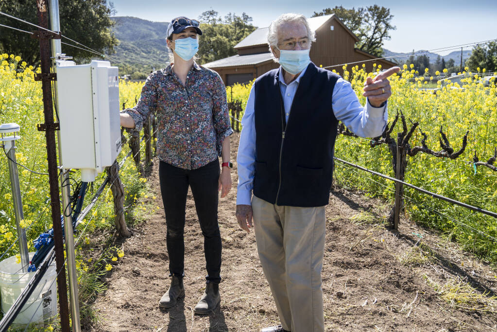 Warren Winiarski with Beth Forrestel, an assistant professor in the Department of Viticulture and Enology at the University of California Davis. Winiarski is funding work to measure effects of climate change on wine growing. There are 18 monitoring sites set up in the Napa Valley with some high-tech tools to more precisely measure environmental conditions related to climate change.