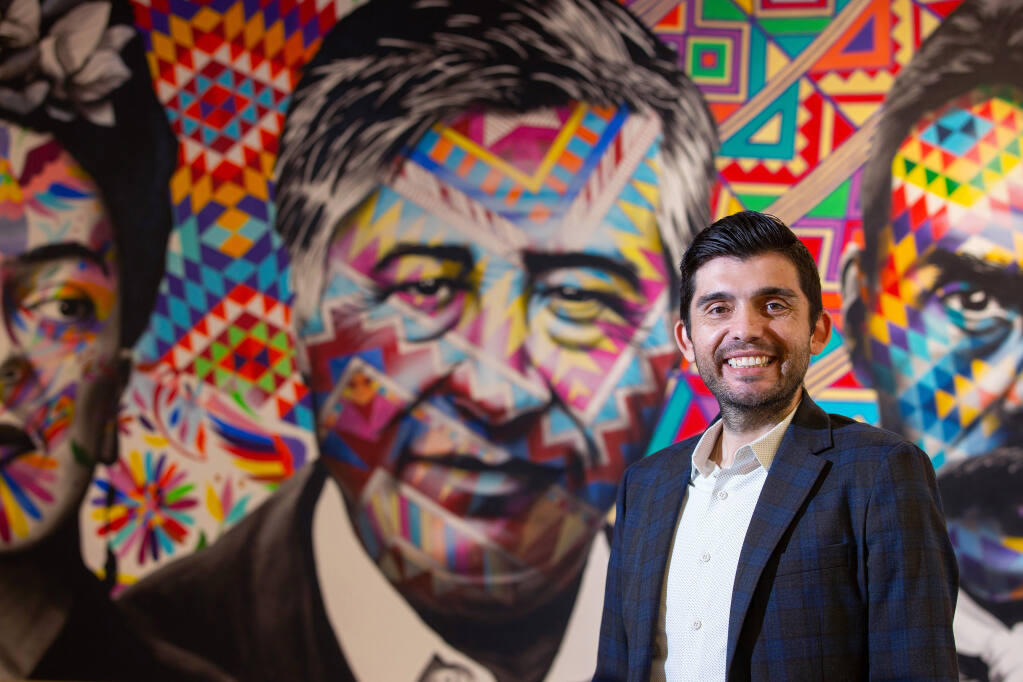 Glaydon de Freitas, newly appointed CEO of Corazon Healdsburg, poses for a portrait in front of a mural featuring artist Frida Kahlo, civil rights leader César Chávez and Mexican Revolutionary leader Emiliano Zapata at the nonprofit organization's headquarters in Healdsburg on Thursday, Nov. 5, 2020. (Alvin A.H. Jornada / The Press Democrat)