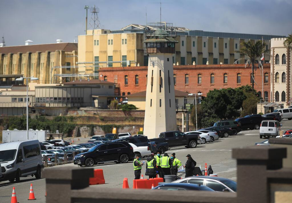 Medical personnel are staged just inside the gate of San Quentin State Prison for screening and temperature checks for those coming into the prison for business, Thursday, July 16, 2020, in San Quentin. (Kent Porter / The Press Democrat) 2020