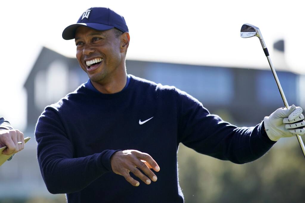 Tiger Woods smiles after hitting his tee shot on the 16th hole during the Genesis Invitational pro-am at Riviera Country Club, Wednesday, Feb. 12, 2020, in the Pacific Palisades area of Los Angeles. (AP Photo/Ryan Kang)
