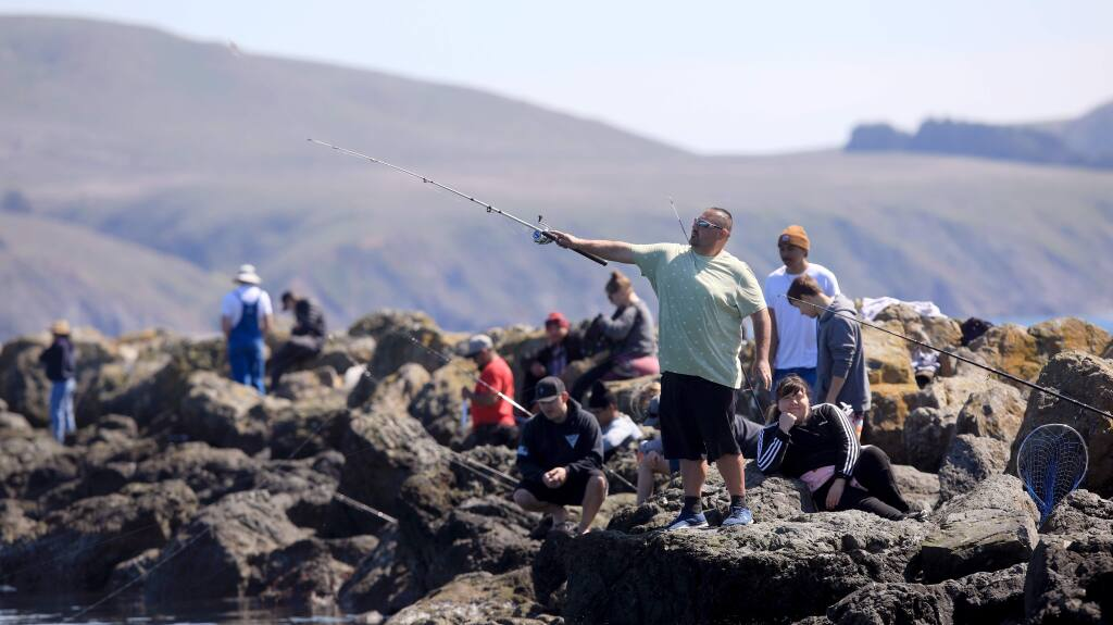 The jetties in Bodega Bay were popular with fisherman, Saturday, March 21, 2020 as Sonoma County residents crowded coastal beaches after five days of sheltering in place in response to the COVID-19 pandemic. (Kent Porter / The Press Democrat) 2020