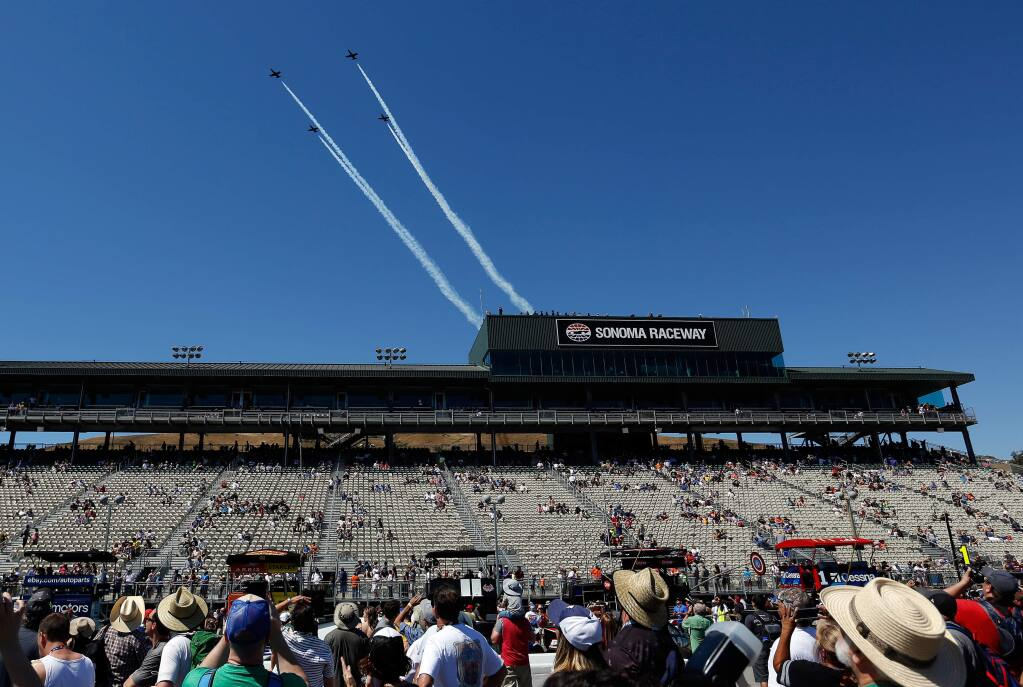 The Patriots Jet team flies above the main grandstand in the pre-race show before the Monster Energy NASCAR Cup Series Toyota/Save Mart 350 race at Sonoma Raceway, in Sonoma on Sunday, June 24, 2018. (Alvin Jornada / The Press Democrat)