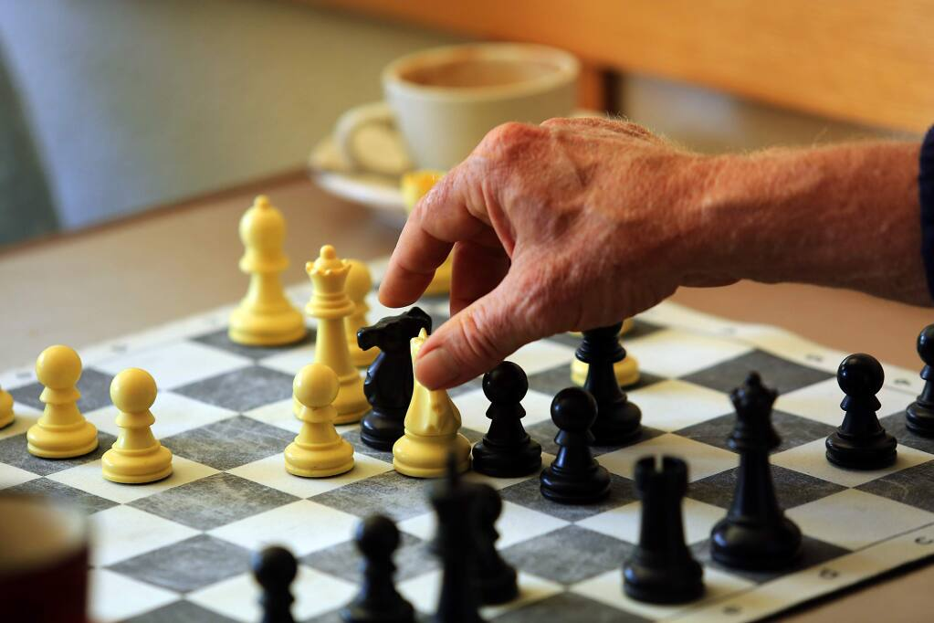 -Bruce Wishard takes Ed Colletti's rook during a match last month at SoCo Coffee in Santa Rosa. Chess players regularly gather at the coffeehouse for pickup games.